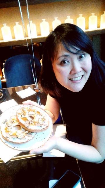 Kiyomi w $1000 bagel.jpeg